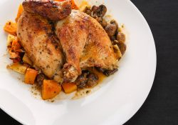 half wood stone rotisserie chicken with roasted vegetables