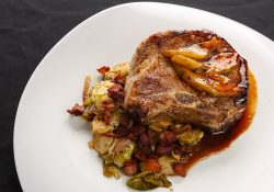dry aged pork chop, apple cider pan sauce, pears and roasted vegetables